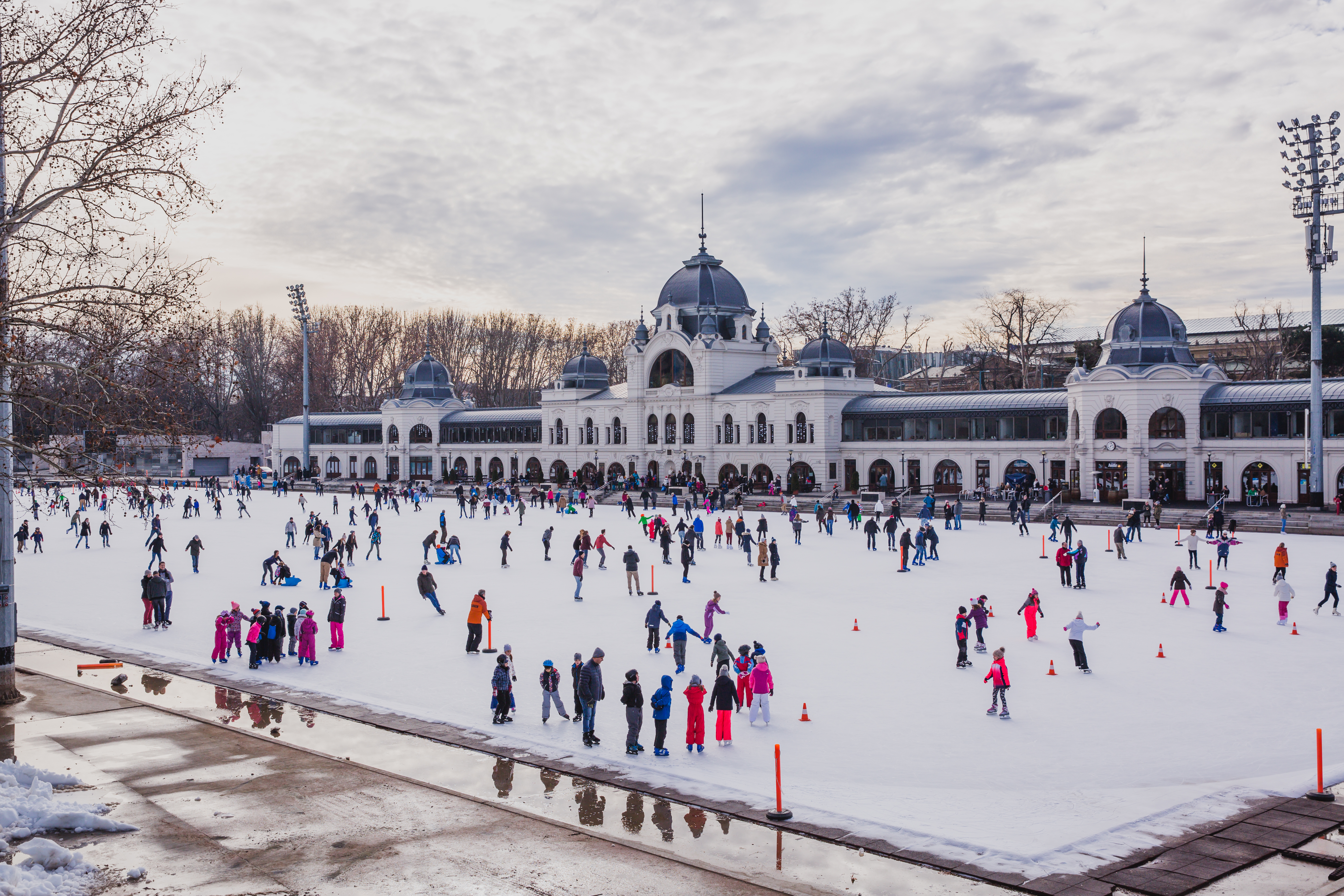 BUDAPEST, HUNGARY - DECEMBER 31, 2018: Many people spend their holidays skating in City Park ice rink in Budapest, Hungary