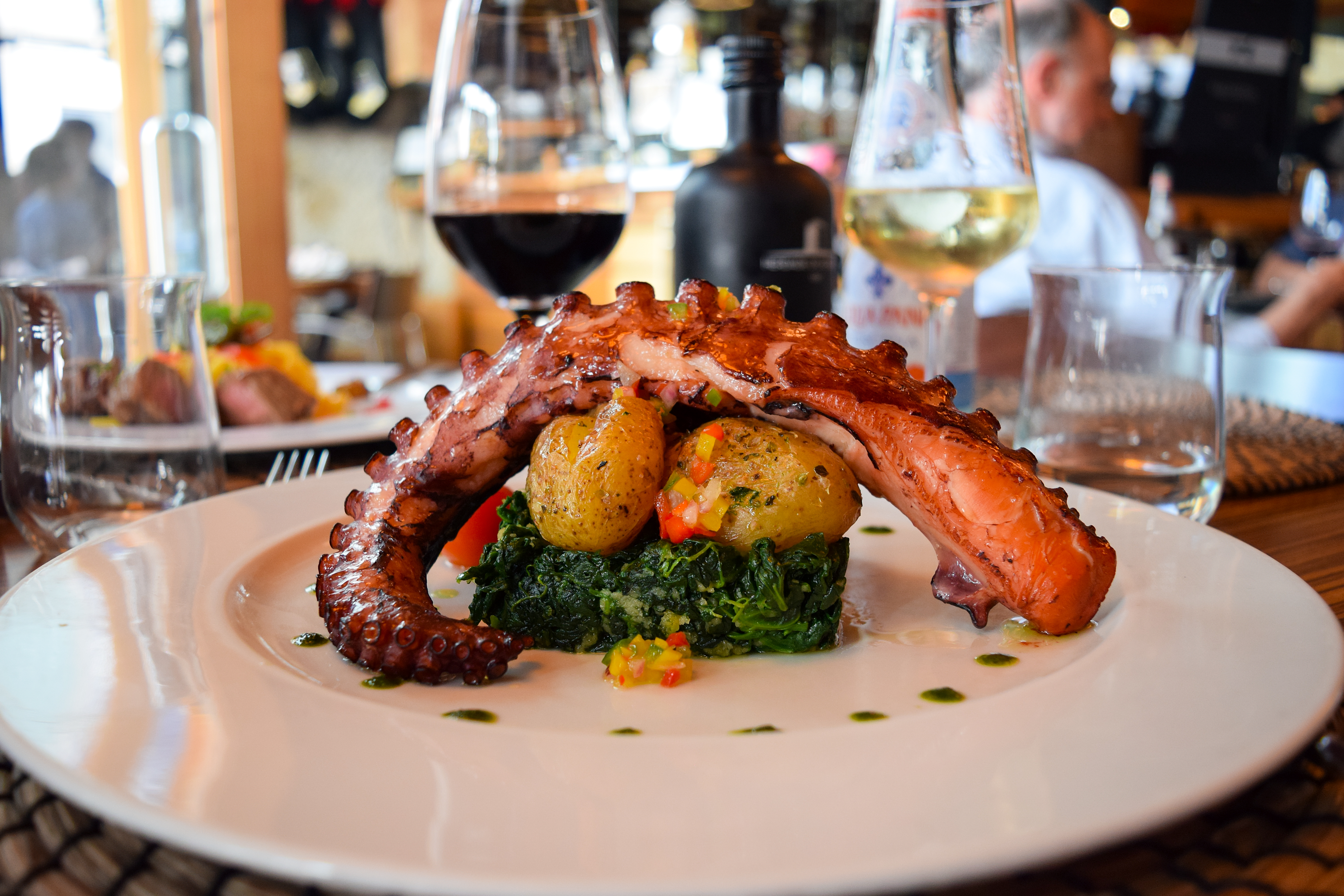 Grilles octopus, potato, red wine glass